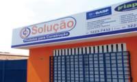 Logo de Solução Produtos para Construção em Dias Macedo